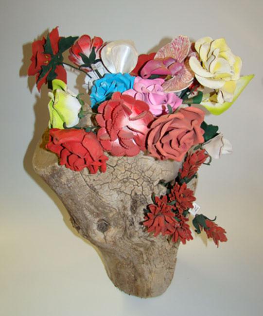 Flower bouquet in wood log vase