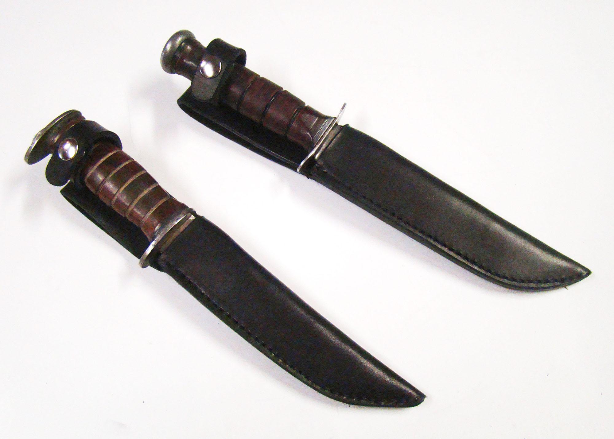 Hunting knife sheaths on white background