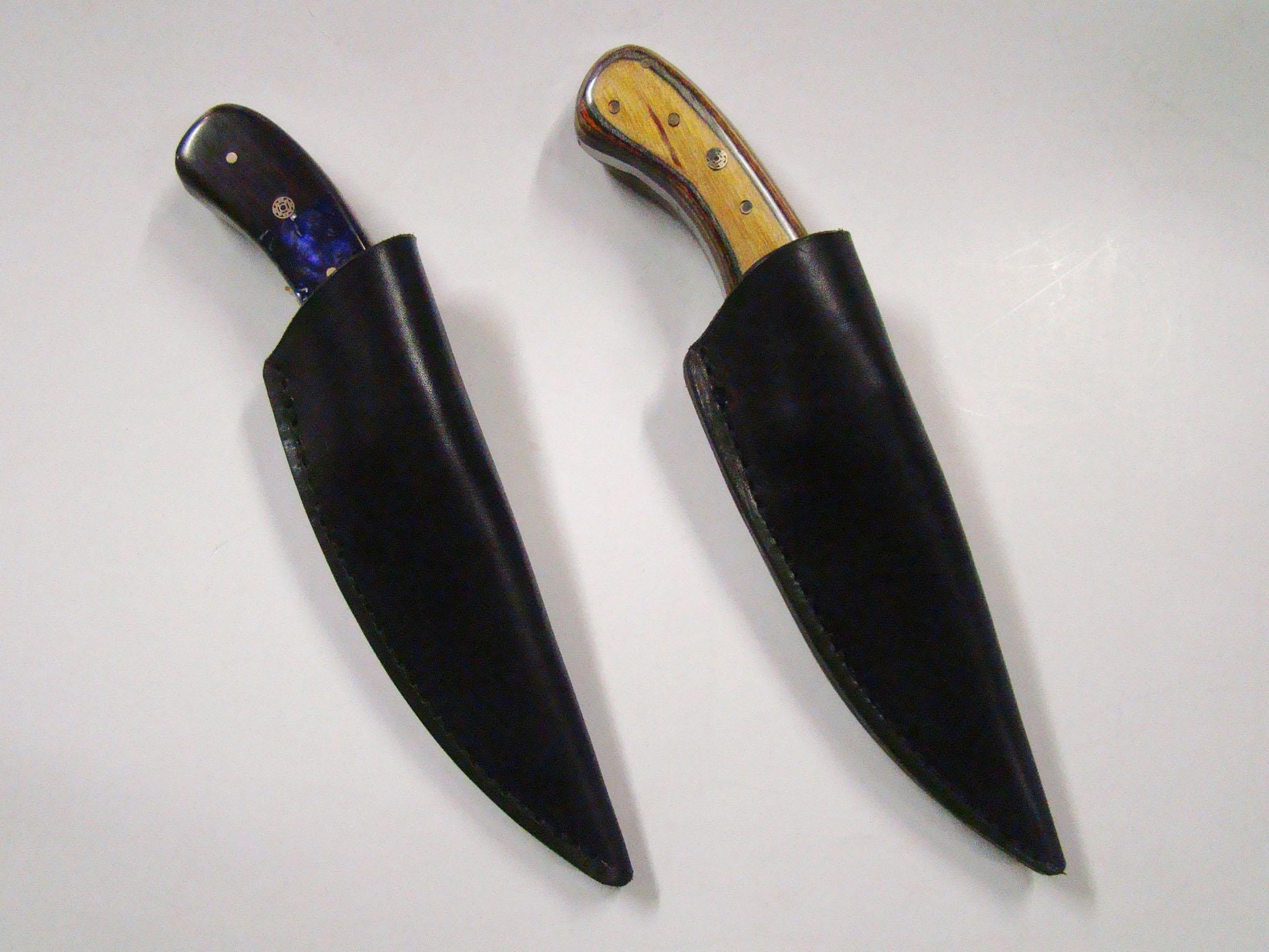 2 dark leather knife sheaths