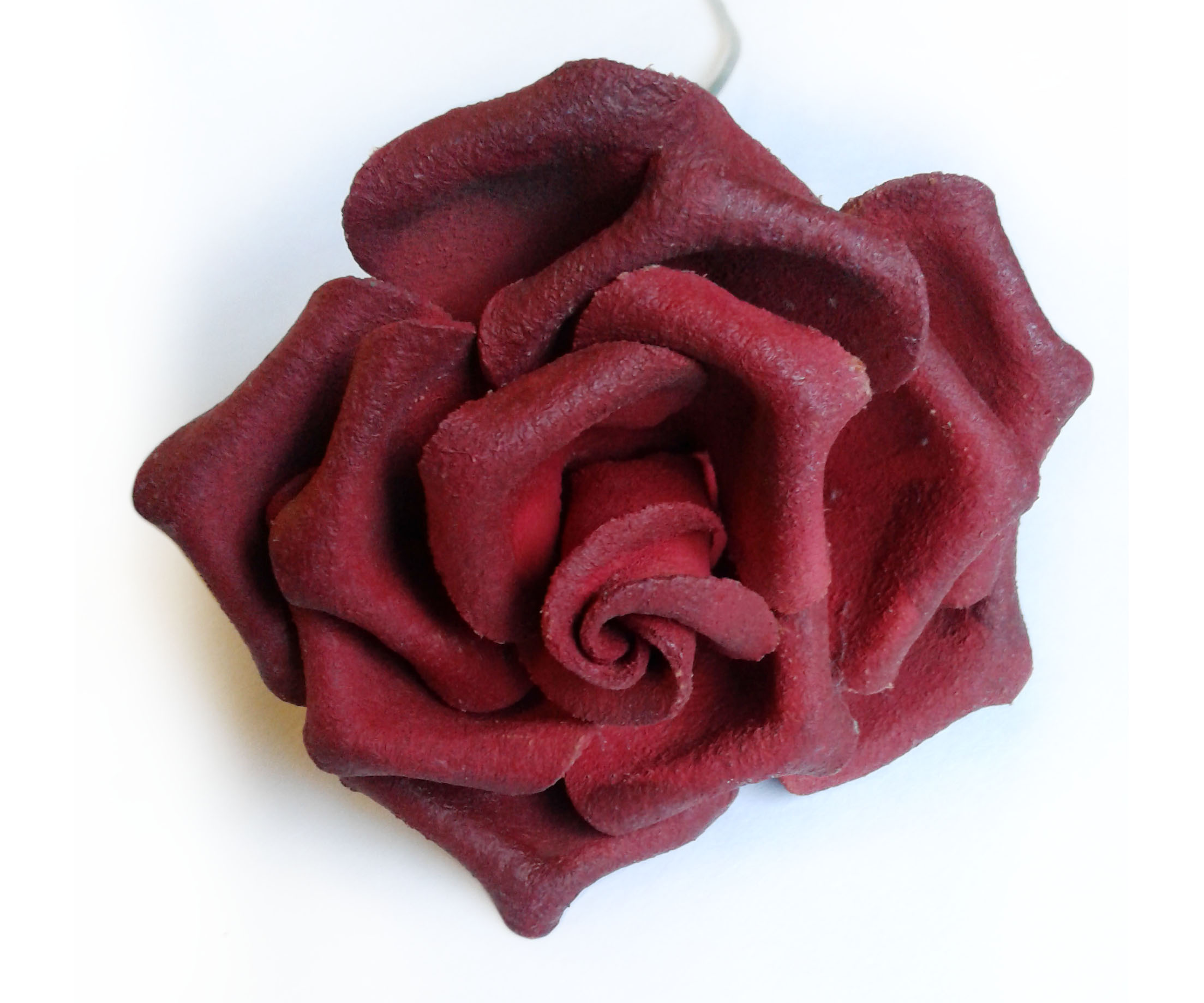 Red leather rose on white