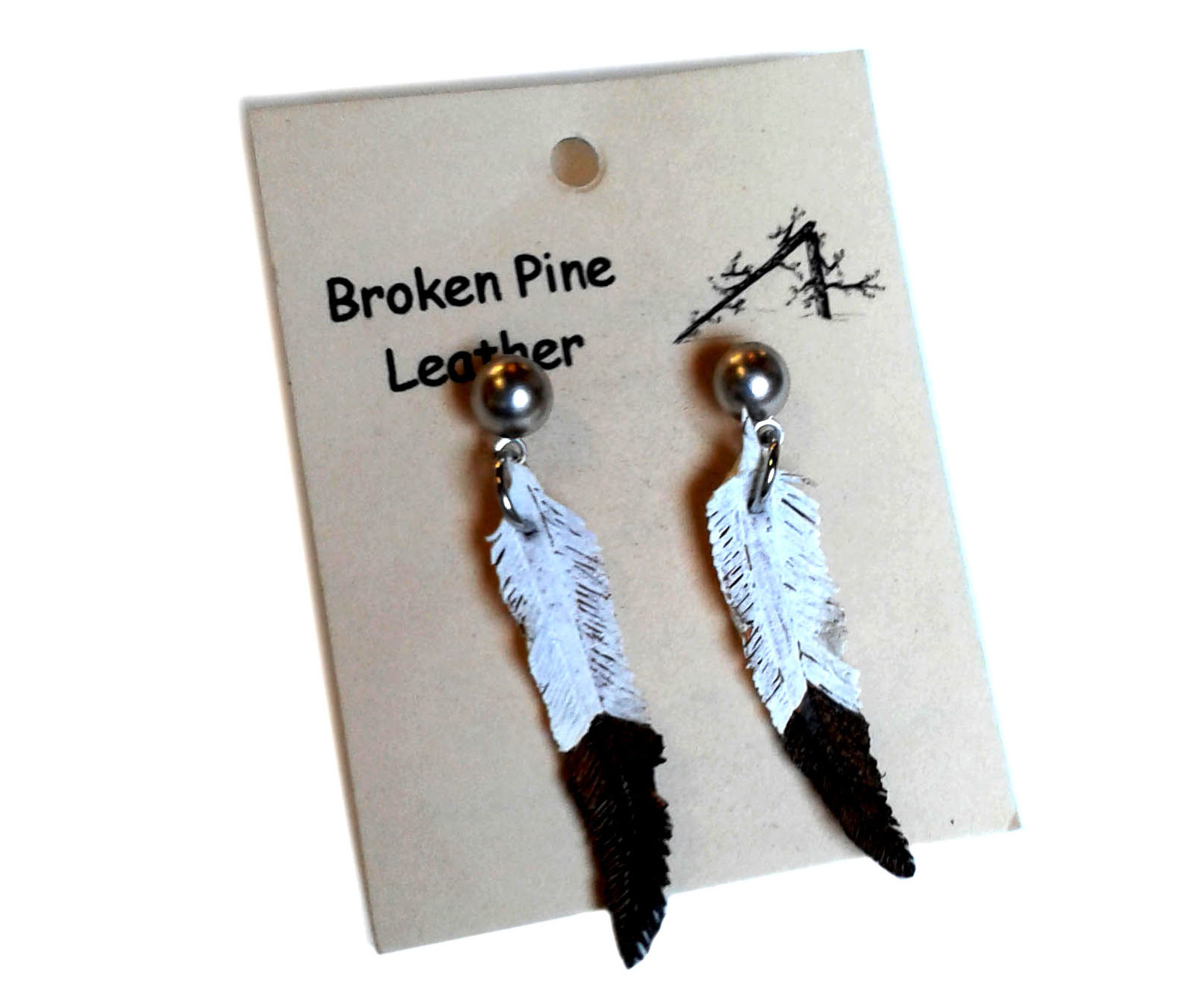 feather earrings on white background